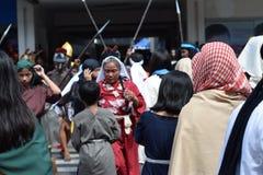Mob of furious women persecuting Jesus Christ gaher on plaza cheering, ridicule, street drama, community celebrates Good Friday re. San Pablo City, Laguna royalty free stock images
