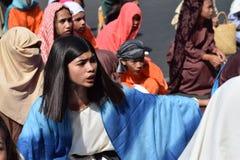 Mob of furious women persecuting Jesus Christ gaher on plaza cheering, ridicule, street drama, community celebrates Good Friday re. San Pablo City, Laguna stock photography