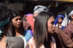 Mob of furious women persecuting Jesus Christ gaher on plaza cheering, ridicule, street drama, community celebrates Good Friday re. San Pablo City, Laguna royalty free stock photography