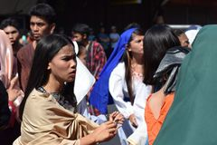 Mob of furious women persecuting Jesus Christ gaher on plaza cheering, ridicule, street drama, community celebrates Good Friday re. San Pablo City, Laguna stock images