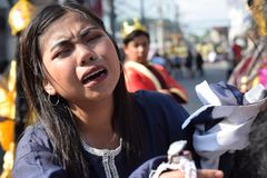 Real tears emit from the eyes of a woman feeling pity to Jesus Christ, street drama, community celebrates Good Friday representing stock images