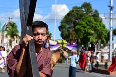 Unidentified people playing role of thieves carrying cross on street. San Pablo City, Laguna, Philippines - April 14, 2017: Unidentified people playing role of Royalty Free Stock Photography