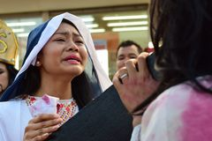 Unidentified woman crying in pity approach role playing jesus christ. San Pablo City, Laguna, Philippines - April 14, 2017: Unidentified woman crying in pity Royalty Free Stock Photos