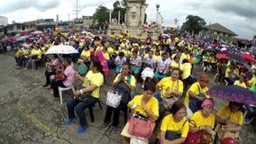 Faithful Catholics gather at church square celebrating jubilee. San Pablo City, Laguna, Philippines - December 5, 2017: Faithful Catholics gather at church stock video