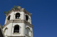 Old Church tower under blue sky. San Pablo City, Laguna, Philippines - December 3, 2016: Old Church tower under blue sky Royalty Free Stock Photo