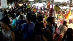 People on wet flea market new year rush shopping