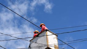 Electrical Workers On Telehandler With Bucket installing High tension wires. San Pablo City, Laguna, Philippines - February 26, 2018: Electrical Workers On stock video