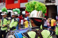 Band musicians play bass drum during the annual brass band exhibition. San Pablo City, Laguna, Philippines - January 15, 2016: Band musicians play bass drum Royalty Free Stock Photo