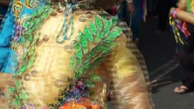 Close up image of folk and cultural dancers in coconut costume dancing along the streets to celebrate patron saint. San Pablo City, Laguna, Philippines stock footage