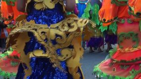 Close up image of folk and cultural dancers in coconut costume dancing along the streets to celebrate patron saint. San Pablo City, Laguna, Philippines