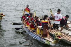 Competing team of people embark on Sports Native Row Dragon head Boats. San Pablo City, Laguna, Philippines - January 9, 2016: Competing team of people embark on royalty free stock photography
