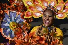 Female Street dancer in colorful coconut costumes join festivity. SAN PABLO CITY, LAGUNA, PHILIPPINES - JANUARY 13, 2017: Female Street dancer in colorful Royalty Free Stock Photo