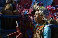 Male Street dancer in colorful coconut costume dance on the street. SAN PABLO CITY, LAGUNA, PHILIPPINES - JANUARY 13, 2017 Male Street dancer in colorful coconut Royalty Free Stock Photography
