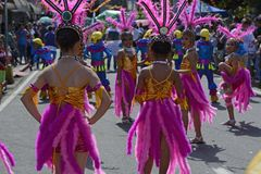 Street dancer in head dresses with colorful coconut costume perform on the road. San Pablo City, Laguna, Philippines - January 13, 2017: Street dancer in head Stock Photography