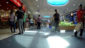 Modern indoor shopping mall stalls. tracking shot