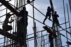 A group of Filipino Construction steel workers assembling steel bars on high-rise building with no proper protective suits and saf. San Pablo City, Laguna Stock Photos