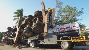 Crane truck overturned on tanker truck. San Pablo City, Laguna, Philippines - November 21, 2015: crane truck overturned fell over a loaded flammable carrying stock video