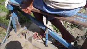 Railroad trolley operator drives foot driven passenger cart. San Pablo City, Laguna, Philippines - November 5, 2012: railroad trolley operator drives foot driven stock footage