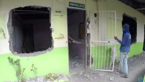 Construction worker demolishing principal`s office room. San Pablo City, Laguna, Philippines - October 27, 2017: Construction worker demolishing, hammer smashing stock video footage