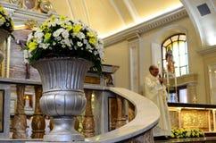 Roman Catholic priest saying homily at altar. San Pablo City, Laguna, Philippines - October 20, 2016: Roman Catholic priests celebrates congregation homily mass royalty free stock photography