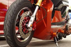 Close up of big motorcycle front wheel, focus tyre. San Pablo City, Laguna, Philippines - September 12, 2015: close up of big motorcycle front wheel, focus tyre Royalty Free Stock Photos