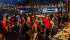 Serving a meal to the community at the Calenda San Pedro in Mexico. royalty free stock photography