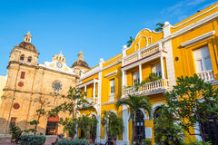 San Pedro Claver Plaza. Church and yellow colonial building visible from San Pedro Claver plaza in historic Cartagena, Colombia Royalty Free Stock Photos