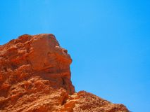 San pedro de atacama chile may face silhouette in the cliff. Near pre cloumbian ruins Stock Photography