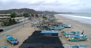 San Pedro, Ecuador - 20180915 - Drone Aerial - Flight Along Beach Over Parked Fishing Boats and Fishermen Fixing Nets. San Pedro, Ecuador - 20180915 - Drone stock video