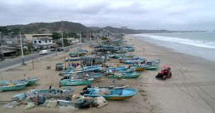San Pedro, Ecuador - 20180915 - Drone Aerial - Flight Along Beach Over Parked Fishing Boats and Tractor. San Pedro, Ecuador - 20180915 - Drone Aerial - Flight stock video