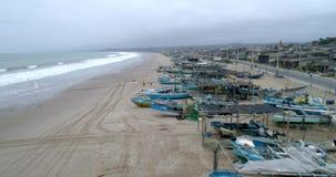 San Pedro, Ecuador - 20180915 - Drone Aerial - Flight Along Beachfront and Parked Fishing Boats. San Pedro, Ecuador - 20180915 - Drone Aerial - Flight Along stock footage