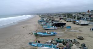 San Pedro, Ecuador - 20180915 - Drone Aerial - Flight Along Beachfront with Parked Fishing Boats and Crude Shelters. San Pedro, Ecuador - 20180915 - Drone stock video footage