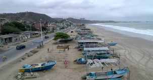 San Pedro, Ecuador - 20180915 - Drone Aerial - Flight Along Nearly Deserted Beach Over Parked Fishing Boats. San Pedro, Ecuador - 20180915 - Drone Aerial stock video footage