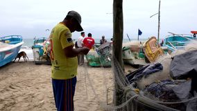San Pedro, Ecuador - 20180915 - Man Fixes Net He Has Attached to Pole. stock video footage