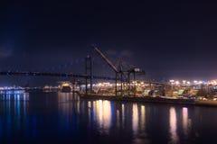 The Vincent Thomas Bridge, Los Angeles. San Pedro, Los Angeles, California, USA - September 20th, 2017: The Vincent Thomas Bridge and port cranes at night at Royalty Free Stock Photos