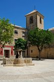 San Pedro Square, Ubeda, Andalusia, Spain. Fountain and church in the Plaza San Pedro, Ubeda, Jaen Province, Andalusia, Spain, Western Europe Royalty Free Stock Photos