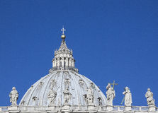 San Pietro church. Close-up shot of the Colonade of St. Peters Square in Vatican City with the dome of St. Peters in the background Royalty Free Stock Photography