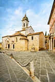 San Quirico Collegiata church and medieval square. Val d Orcia, Royalty Free Stock Image