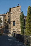 SAN QUIRICO D`ORCIA, ITALY - OCTOBER 30, 2016 - Charming narrow street in the town of San Quirico d`Orcia. Province of Siena, Val d`Orcia, Tuscany, Italy royalty free stock photography
