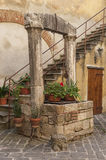 SAN QUIRICO D`ORCIA, ITALY - OCTOBER 30, 2016 - Picturesque traditional Italian courtyard in the center of San Quirico d`Orcia. Val d`Orcia, Tuscany, Italy Stock Photo