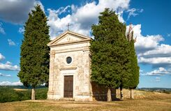San Quirico d`Orcia, Tuscany, Italy. August 2020. The fascinating Chapel of the Madonna di Vitaleta on a beautiful sunny day. Blu