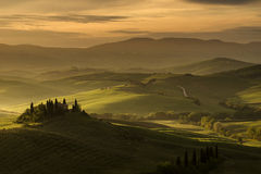 San Quirico d'Orcia, Val d'Orcia, Tuscany. Stunning view at sunrise of Podere Belvedere, the most famous location in San Quirico d'Orcia, Val d'Orcia, Tuscany Royalty Free Stock Photo