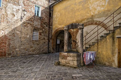 San quirico medieval houses with water well Stock Photo
