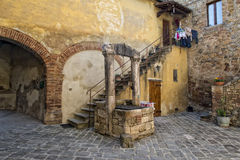 San quirico medieval houses with water well Stock Photos