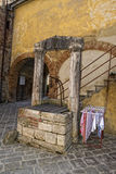 San quirico medieval houses with water well Royalty Free Stock Photo
