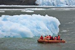 San Rafael Glacier in Patagonia - Chile. Adventure tourists near the San Rafael Glacier in the Laguna San Rafael National Park in the Northern Patagonian Ice Stock Photos