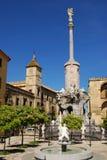 San Rafael Monument, Cordoba, Spain. Garden with fountain and San Rafael's Gate Bridge Triumph Monument (Triunfo de San Rafael) with the Episcopal Palace to the Stock Photos