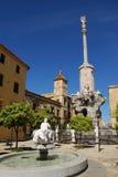 San Rafaels Monument, Cordoba, Spain. Garden with fountain and San Rafaels Gate Bridge Triumph Monument (Triunfo de San Rafael) with the Episcopal Palace to the Royalty Free Stock Image