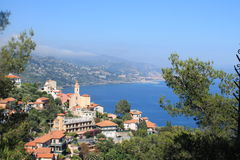 San Remo. Overview, nice location, mountains, water and houses Royalty Free Stock Image