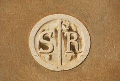 San Rocco symbol. Saint Roch parish old symbol on a wall in Venice royalty free stock photo